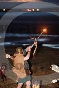Roman archer firing a burning arrow