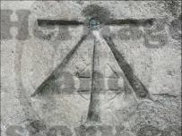 A Cut mark obscures an earlier stone masons mark