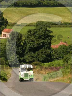 A lovingly restored green and cream 1946 Leyland coach, known as the Heritage Bus