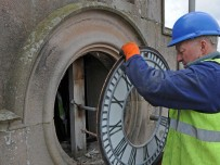 Removal of the clock face at Lowther Castle, Penrith. Pic Val Corbett/Lowther Gardens