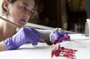 National Trust conservator Kate Berktenshaw cleaning chess pieces at Chirk Castle -Pic NT